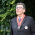 Sir Paul Holmes, during his investiture on the Holmes family farm. Photo / Paul Taylor
