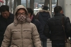 Residents in China respond to heavy pollution that has reached hazardous levels in the capital for several days, with even state media questioning the nation's breakneck development after an eruption of online criticism.