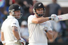 Daniel Flynn, right, signals to the umpire a review on his LBW dismissal as New Zealand's captain Brendon McCullum, left, looks on during day two of their second cricket test match. Photo / AP.