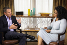 Oprah Winfrey interviewing cyclist Lance Armstrong during taping for the show