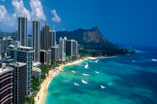 Waikiki Beach on Hawaii's Oahu Island is a cold-climate visitor's idea of bliss. Photo / Getty Images