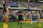 Boca Juniors' Rolando Schiavi enters the field as fans - and cheerleaders - go wild. Buenos Aires' most famous football club attracts the most fervent supporters in the world for any sport. Photo / AP