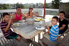 The Oneroa family (clockwise from left) Mapuna, Kevin, Cherie, Eru and Matapia, always eat together. Photo / Natalie Slade