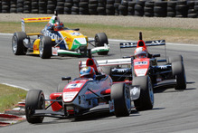 Felix Serralles stays ahead of Alex Lynn on the Teretonga track. Photo / Euan Cameron