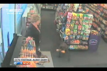 A three-legged dog steals dog roll from an Invercargill dairy. Photo / 3News