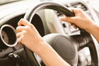 The traditional 10 and two position could lead to airbag injuries. Photo / Getty Images
