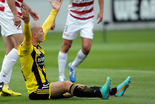 Stein Huysegems of the Phoenix appeals to the referee after being brought down in a tackle. Photo / Getty Images