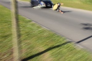 The teenager was knocked unconscious after being towed on his skateboard.