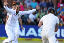 South Africa's bowler Robin Peterson (left) dismisses New Zealand's Brendon McCullum (right). Photo / AP