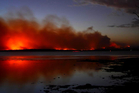 In this photo provided by the New South Wales Rural Fire Service a fire burns near Sussex Inlet, Australia. Photo / AP