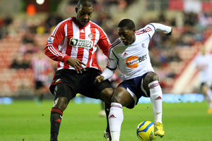 Bolton Wanderers' Marvin Sordell, right, vies for the ball with Sunderland's Titus Bramble, during their FA Cup third round replay, won 2-0 by Bolton. Photo / AP