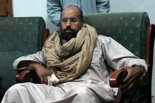 Saif al-Islam is seen after his capture in the custody of revolutionary fighters in Zintan, Libya. Photo / AP