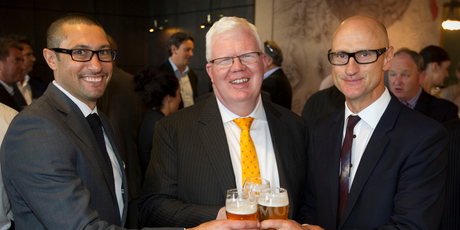 Moa Beers marketing manager Sunil Unka (left) and chief executive Geoff Ross (right) enjoy a toast with NZX chief executive Tim Bennett after listing.  Photo / Greg Bowker
