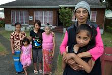 The Shwe family (left) with their neighbour Cheryl Manukau and her daughter. Photo / Brett Phibbs