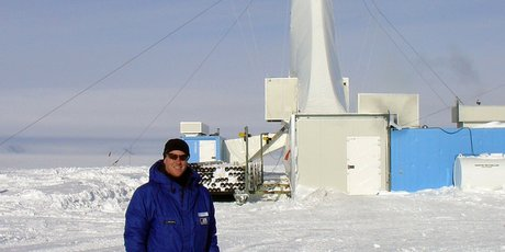 Antarctic Research Centre director Tim Naish with the drill rig that pierced the Ross Ice Shelf. Photo / NZ Herald