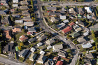 Aerial view of liquefaction and earthquake damaged houses in Burwood, Christchurch. Photo / Geoff Sloan