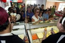 Customers queue for ice creams at the Cool Cat Ice Cream Parlour at Ahuriri. Photo / APN