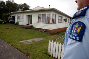 Dargaville Police Senior Sergeant Rob Nordstrom outside the Tirarau Street property where two police officers were assaulted. Photo / John Stone