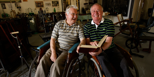 Dr John Swinney, left, and Kiwi North director Stewart Bowden seated in a couple of wheelchairs that feature in the new medical museum. Photo / John Stone