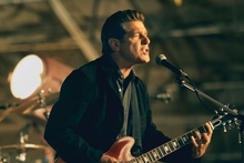 Glenn Frey in action and with the Eagles in their early days. Photo / Supplied