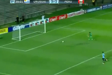 Peruvian keeper Ángelo Campos chases down a shot to make a desperate save. Photo / YouTube