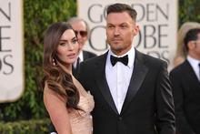 Megan Fox and her husband Brian Austin Green arrive at the Golden Globes. Photo/AP