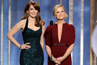 Tina Fey, left, and Amy Poehler deliver their opening monologue. Photo/AP