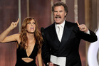 Kristen Wiig, left, and Will Ferrell presenting at the Golden Globes. Photo/AP
