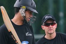 Ross Taylor and coach Mike Hesson chat during a training session in  Pallekele last year. Photo / AFP