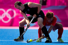 New Zealand defender Blair Hopping in action against Korea's at the London Olympics. Photo /  Brett Phibbs
