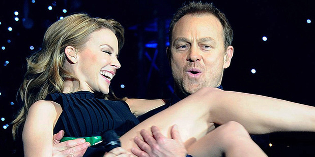 Kylie Minogue in the arms of Jason Donovan during a Christmas performance. Photo/AP