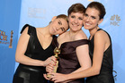 Zosia Mamet, left, Lena Dunham and Allison Williams pose at the Golden Globes. Photo/AP