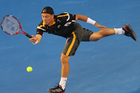 Lleyton Hewitt of Australia plays a forehand in his first round match against Janko Tipsarevic of Serbia. Photo / Getty Images