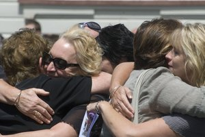 Friends and family of Featherston man Glen Jones embrace at his funeral service at the Anzac Hall in the town yesterday. Photo / Nathan Crombie