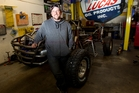Trevor Cooper with his off-road buggy, one of the many vehicles he has bought since his big win. Photo / Kellie Blizard