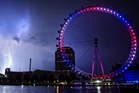 The London Eye is lit up in the national colours of red, white and blue to mark the royal birth. The new Prince faces a very long wait to take his turn on the throne.