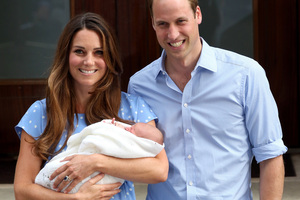 Kate Middleton and Prince William show off their new baby wrapped in Aussie wool.Photo / AFP