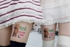 Girls in Japan are paid to wear short skirts and stick ads to their thighs.Photo / ITN