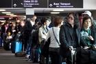 Passengers queue to change their flights yesterday. Photo / Natalie Slade