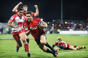 Dan Carter of the Crusaders goes over for his try. The playmaker's form has allowed his backs to cut loose. Photo / Getty Images