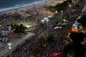 Pilgrims from 175 nations greeted the Pope at the beach. Photo / AP