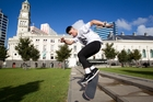 Skateboarder Max Harris (18) performs a hard-flip at Aotea Square. Photo / Richard Robinson