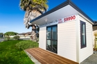 Sleepouts built in China are insulated, double-glazed, have a deck and are being sold in New Zealand from $9990.