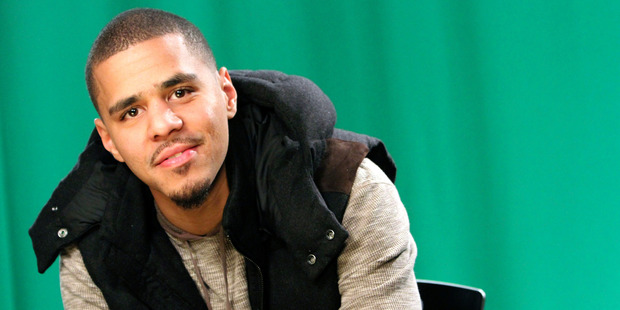 J Cole has apologised for using an offensive lyric in a song with Drake. Photo / AP