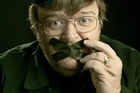 Michael Moore has filed for divorce.