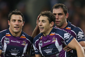 Cameron Smith and Cooper Cronk congratulate Billy Slater of the Storm. Photo / Getty Images.
