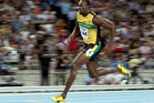 Scientists today said Usain Bolt performed a feat of biomechanics when he ran 100m in a record 9.58sec at the 2009 World Championships in Berlin. Photo / Getty Images.