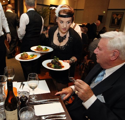 L-R: Hannah Cochrane, waitress, Peter Rowell, Auckland, pictured during a break of the Radio Play, an event at The Gatsby Room, Masonic Hotel, Napier, part of DIY Deco Weekend, a mid-winter Art Deco festival