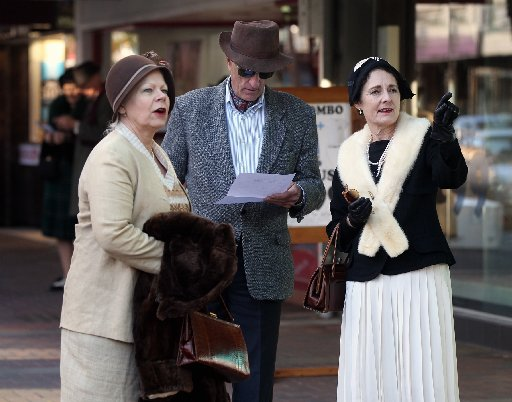 L-R: Nina Craig, Te Aroha, Ed Hamilton, Kirsty Hamilton, Wellington, pictured in Emerson St, Napier, taking part in a Scavenger Hunt, an event using cryptic clues to correctly identify buildings in the Napier CBD, part of DIY Deco Weekend, a mid-winter A