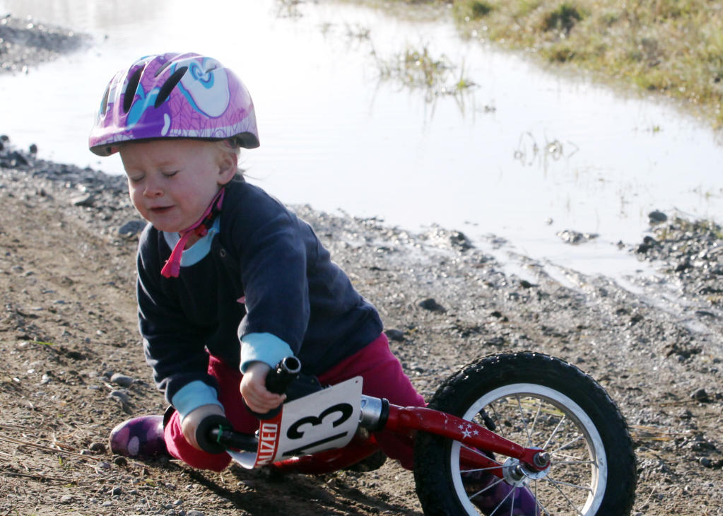 Bea Stewart, 2, takes a fall during the Kids B grade under sevens race CXHB Cyclocross Series.